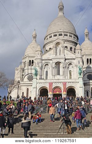 Paris, France, February 6, 2016: The Sacre-Coeur Basilica on Montmartre, well-known bohemian area in Paris, France,