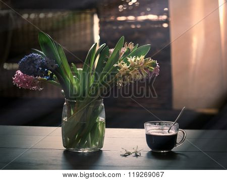 Good morning. Spring bouquet and cup of coffee