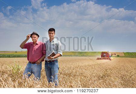 Peasant And Businessman At Harvest