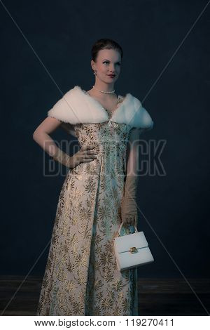 Vintage 50S Posh Fashion Woman In Gold Dress Holding Handbag.