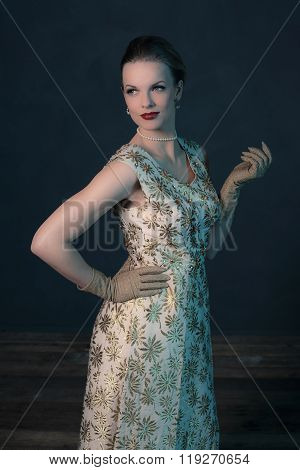 Retro 1950S Posh Fashion Woman In Gold Dress.