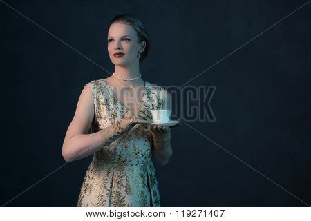 Chic Vintage 1950S Fashion Woman Holding White Tea Cup.