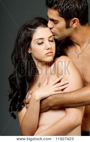Sexy young ethnic couple having a romantic moment