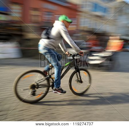 Cyclist On The City Roadway