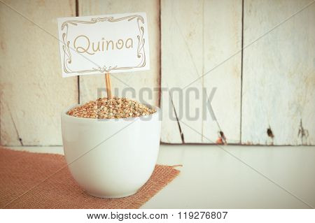 Some quinoa seeds in a bowl in the herbalist's.