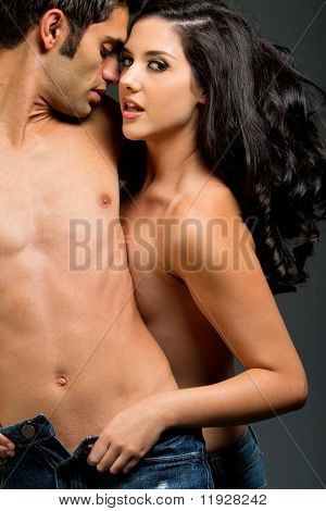 Sexy young ethnic couple in love
