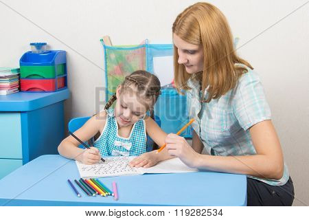 The Young Girl Engaged In A Five Year Old Girl Spelling
