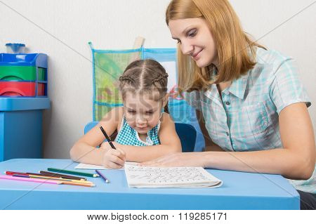 Tutor Sees That The Child Turns Out To Write Letters Of The Alphabet