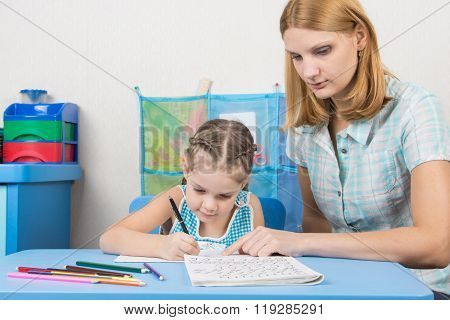 Tutor Helps The Child To Spell The Alphabet