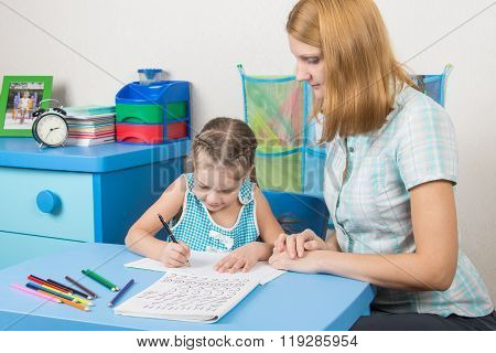 Five-year Girl Learns To Write Letters Correctly, A Tutor Helps Her