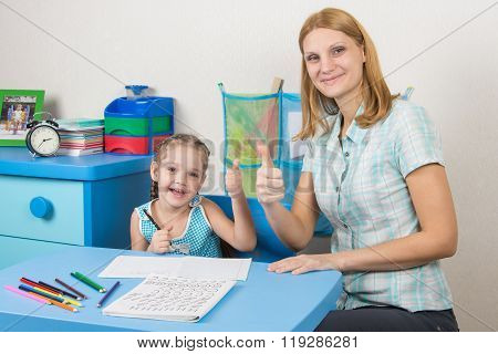 Mentor And Five-year Girl Joyfully Show The Thumbs Up By Doing A Regular Job