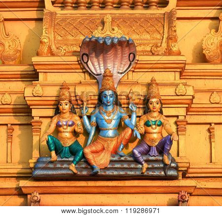 Lord Vishnu statue on exterior architecture of hindu temple