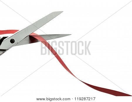 Scissors Cutting A Red Ribbon. Clipping Path