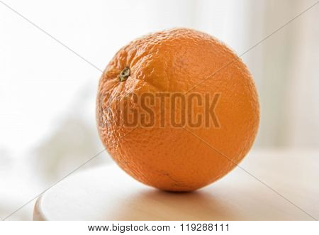 One Orange Fruits On Wooden Table Isolated