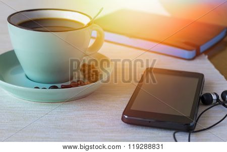 Cup of coffee with phone and note-book. Morning calm concept