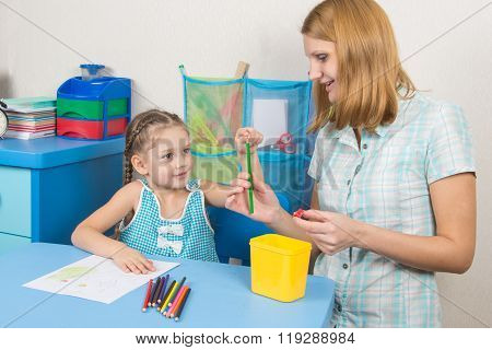 The Five-year Child Put A Finger On The Tip Of A Pencil Mom