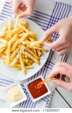 Hands Picking French Fries