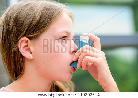 Girl Uses An Inhaler During An Asthma Attack