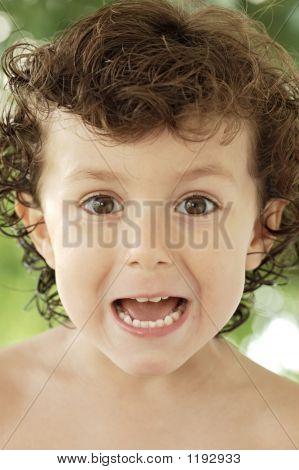 Adorable Happy Boy Making Trivialities