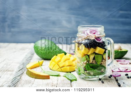 Homemade Healthy Salads With Black Beans, Vegetables, Fruits, And Quinoa In Jar