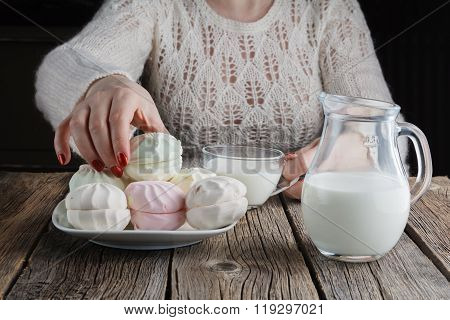 Closeup On Woman Taking Out Marshmallow