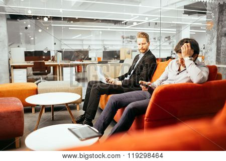 Succesful Businesspeople Working On Devices