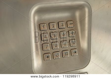 dial number button on used public telephone