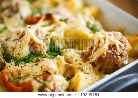 Vegetable casserole with potatoes and meatballs