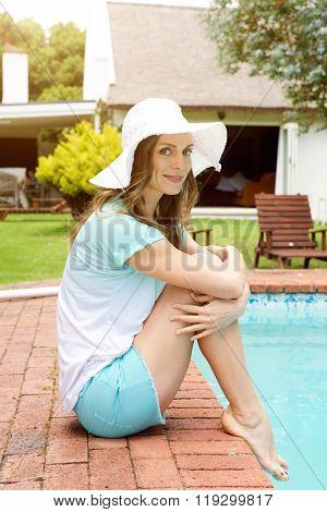 Older Woman Smiling By Poolside