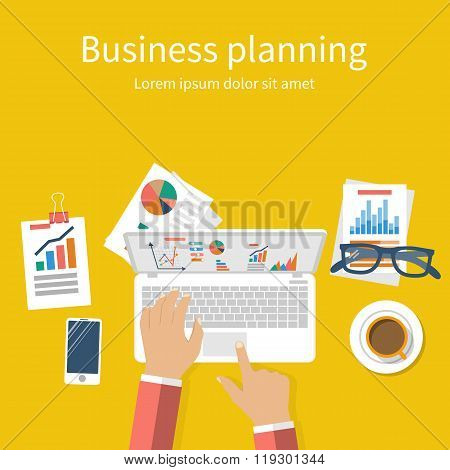 Business Planning Concept. Businessman At Table With Laptop
