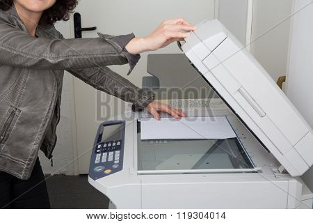 Woman's Hands And Body With Working Copier