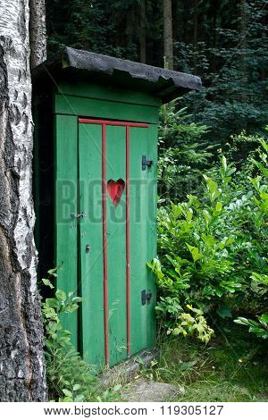 Rural old outhouse in summer