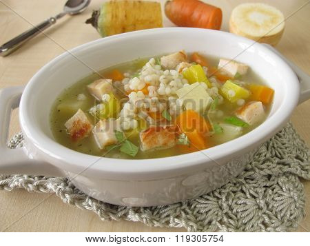 Vegetable soup with pearl barley and chicken
