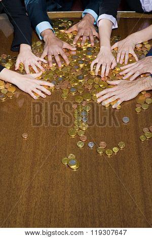 Hands grabbing coins