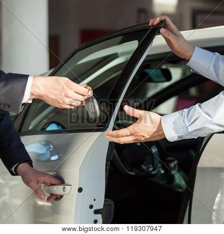Salesman's Hands Giving Key