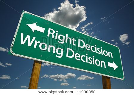 """Right Decision, Wrong Decision"" Road Sign with dramatic blue sky and clouds."