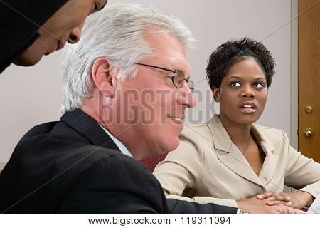 Woman looking at men whispering