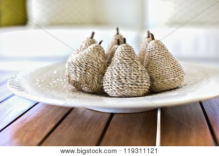 Fruit Shaped Decoration Item On A White Plate