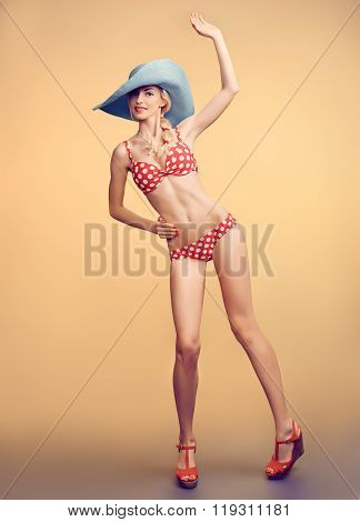 Sexy PinUp woman in polka dots swimsuit,beach body