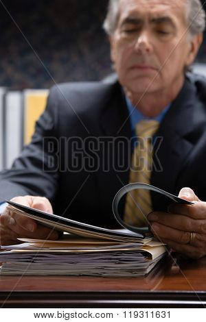 Businessman looking at file