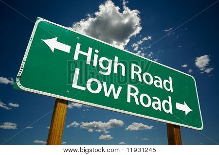 """High Road, Low Road"" Road Sign with dramatic clouds and sky."