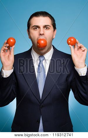 Businessman holding tomatoes
