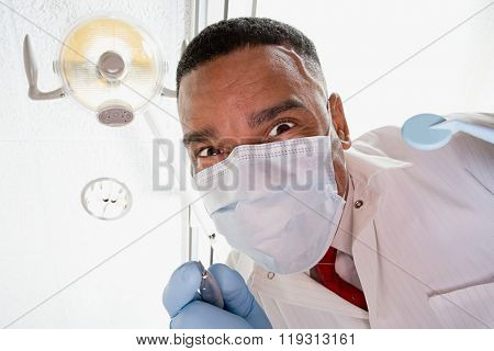 Low angle view of dentist and dental nurse