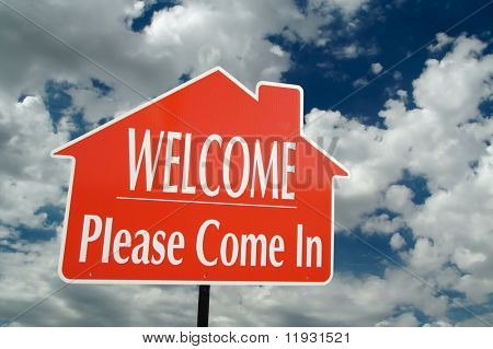 Welcome, Please Come In Real Estate Sign with clouds in the background.