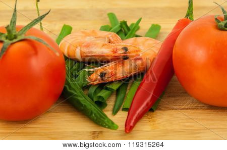 Two Cooked Unshelled Tiger Shrimps With Red Tomatoes, Fresh Chives And Pepperoni, On A White Backgro