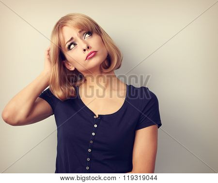 Puzzled Stressed Thinking Young Woman Looking Up On Empty Copy Space And Scratching The Head. Vintag