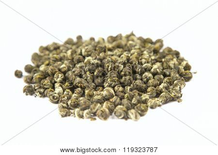 Oolong leaves rolled into balls isolated on white background, selective view