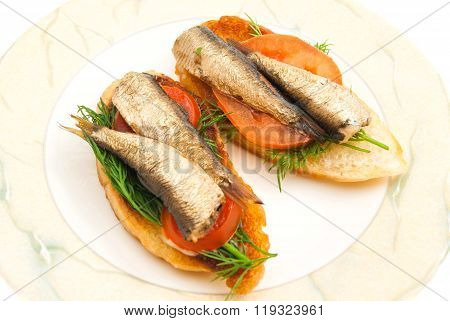 Pair Of Sandwiches With Sprats On A Dish