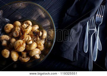 Roasted mushrooms on wood background