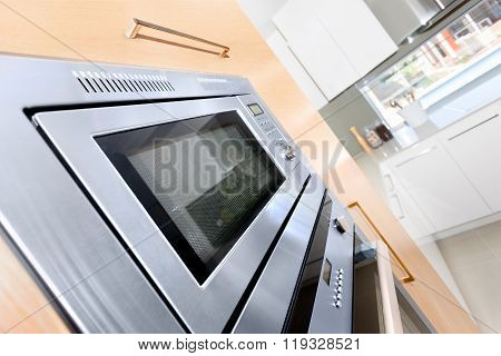 Closeup Of A Modern Oven In A Luxury Kitchen Fixed To The Wooden Wall